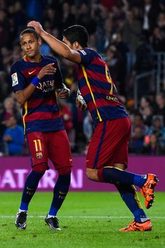 Neymar (L) of FC Barcelona celebrates with his teammate Luis Suarez of FC Barcelona after scoring his team's first goal during the La Liga match between FC Barcelona and Rayo Vallecano at the Camp Nou stadium on October 17, 2015 in Barcelona, Catalonia.