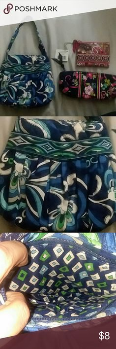 3 Vera Bradley Pieces Small purse, coin purse, and make-up bag! The small purse and coin bag have not been used.. make-up bag was used 1 time and has a couple makeup spots in it (as seen in photo). They obviously don't match eachother but I'm wanting to part ways with the 3 as a bundle! Vera Bradley Bags Mini Bags