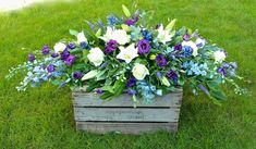 Striking oriental lilies for this double ended spray of White Lilies, Blue Delphiniums and Purple Lisianthus Purple Flower Arrangements, Funeral Floral Arrangements, Dad Funeral Flowers, Delphinium Flowers, Blue Flowers, Casket Flowers, Casket Sprays, Memorial Flowers, Cemetery Flowers
