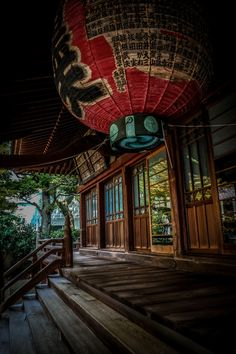 Why do Chinese people hang red lanterns on their stores?