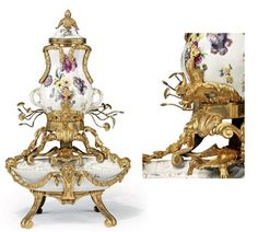 A LOUIS XV ORMOLU AND MEISSEN PORCELAIN FOUNTAIN THE ORMOLU CIRCA 1760, THE PORCELAIN CIRCA 1755, THE MEISSEN FOUNTAIN WITH BLUE CROSSED SWORDS MARK, THE HÖCHST BASIN WITH RED WHEEL MARK