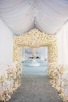 This flower-encrusted archway that will greet your guests like the kings and queens that they are.
