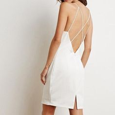 White Strappy Back Bodycon Dress Show off your figure in this bodycon dress! It's made to stun from all angles with its high square neckline and sultry strappy back. You'll find yourself wearing this for special occassions or just going out with the girls on the weekend. Small makeup mark on inside of dress. Forever 21 Dresses Mini