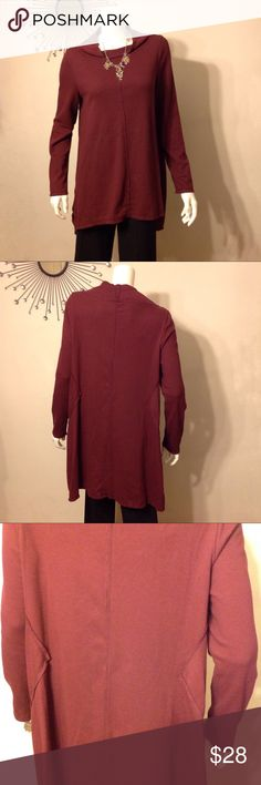 "Neon Buddha Waffle Weave Long Sleeve Tunic Relaxed fit waffle weave tunic. Long sleeve, a-line high-low tunic with boat neckline. Side slit, back stitch detail. Length approximately 28"" front, 33"" back. Fabric content 100% Cotton. NWOT. Color is Burgundy. neon buddha Tops Tunics"
