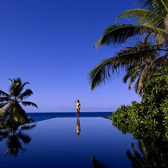 A hotel pool worth flying to: Banyan Tree Seychelles Mahe, Seychelles. Coastalliving.com