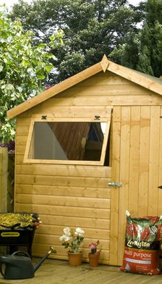 wooden shed with door and opening styrene window