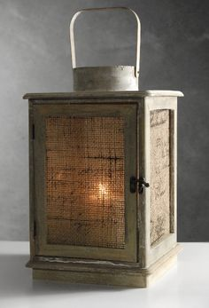 @Megan Welch (ok, I am stopping for the night - but can you tell, I am totally stoked with this burlap theme?)...anyway - look at these lanterns!!! They are burlap lined - would look so awesome on some tables....I know your budget is tight - but just sharing some really great ideas! XXOO