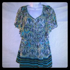 Apt. 9 Multi Colored Aztec Design Flowy Blouse This is a gorgeous blouse from Apt. 9.  It has blue, green, yellow and black aztec designs all over it, with the bottom being a different pattern than the top.  This blouse ties at the bottom of the v-neck, has large ruffled shoulders, very flowy and is size small.  #aztecprint #apt9 #flowy #ruffles Apt. 9 Tops Blouses