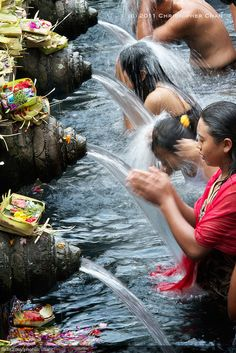 Tirtha Empul Temple in Bali, Indonesia is a Hindu temple, famous for its holy water where Balinese people go for purification. Tirtha Empul Temple was built in 926 A.D. during the Warmadewa dynasty (from the 10th to 14th centuries), at a site where there was a large water spring.  by Christopher Chan