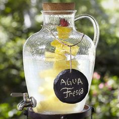Pottery Barn Jug Acrylic Drink Dispenser Uncork the top of this plastic jug and pour in the house-mixed cocktail of your choice, along with any fruit or herbs to add more flavor to each glass. A shaped handle makes for easy carrying to and fro.