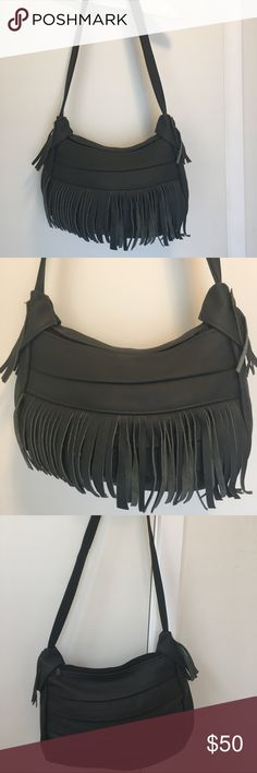 Black fringe leather purse New without tags. Never used. Was a gift and was told it is leather. Looks and feels like leather, it's stylish but it's  just not my style. Very roomy inside with extra zipper compartments both on the outside and inside. Hangs at about 16 inches long on me and I'm 5 ft 1 1/2. Smoke and pet free home. Bags Shoulder Bags