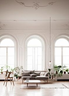 Open room filled with light. Those windows.