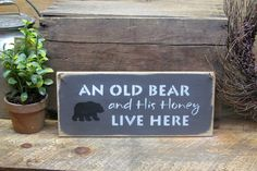 "Front Door Decor, Wooden Sign for the Home. This wooden welcome sign is made from pine, and measures Approx 5.5""W x 13""L. It reads ""An Old Bear And His HOney Live Here"". The front is painted an Espres"