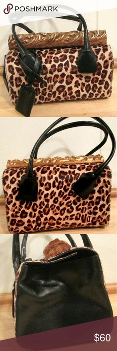 """Calf Skin Cheetah Handbag by Marc and Marc A Stunning Vintage handbag by Marc and Marc by Sharif. Seems to have never been used. Ultra Clean Inside and Out Double Movable Handles: 7"""" Drop Black Genuine Leather Leopard Print Genuine Calf Hair Inside has 1 Large Main Compartment 1 Mirror..still has new sticker on it 1 large zipper compartment 2 additional small slit compartments Snap Top Closure with Wide Gold Tone Ornate Wood Piece. Width: 9"""" Height: 6.5"""" Depth: 6""""  A Very Lovely Handbag to…"""