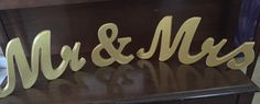 Beautiful Gold Wooden Mr. and Mrs. free standing signs. Great for your Sweetheart Table or your Cake Table!