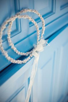 White romantic wreaths from an island wedding in Greece #romanticwreaths  #whitewreaths See more: http://www.love4weddings.gr/romantic-wedding-tinos/