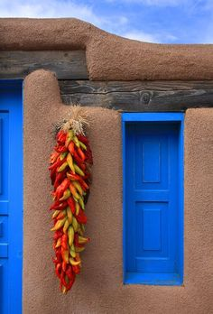 Chile ristras are common decorations around doors and windows on homes in New Mexico  #KlausPriebe