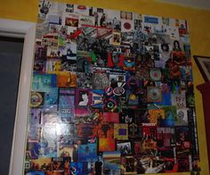 Repurpose CD album cover art in giant wall collage. LOVE THIS SO MUCH. College dorm must.