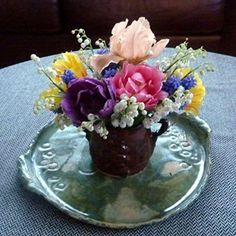 Spring Bouquet of double tulips, lilies of the valley, grape hyacinth, and minature iris...so cheery...