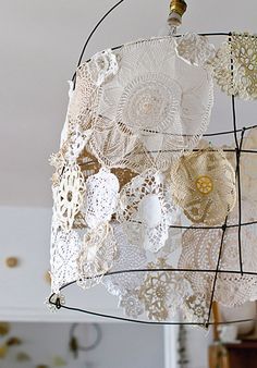 """diy doily wire lampshade  - """"A friend of mine makes wire sculptures and made this for me. I then sewed doilies together to make it into a lampshade. It hangs above our dining table, which is next to my desk."""""""