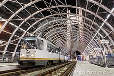 Stationary tram in large modern station on Basarab Overpass Bridge, Bucharest, Romania, one of the largest suspension bridges in Europe.
