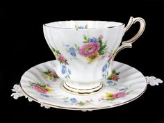 Swirled Floral Queen Anne Teacup and Saucer - Footed High Handled Tea Cup This gorgeous set is in excellent condition! Crisp White Cup with Pretty Floral Sprays There are no cracks, chips, crazing, stains. Very Pretty!! NOTE: To International Customers, Please read my shop policies regarding import duties to your country before buying, thank you.