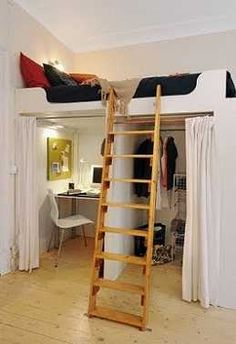 Clever solutions for small spaces. For a studio apartment - desk and closet under the bed.