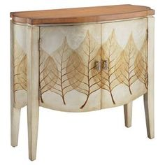 """Curved two-door wood cabinet with tapered legs and a leaf motif.  Product: CabinetConstruction Material: WoodColor: MultiFeatures:  Two doorsAiry leaf motif Dimensions: 30.25"""" H x 33"""" W x 13"""" D"""