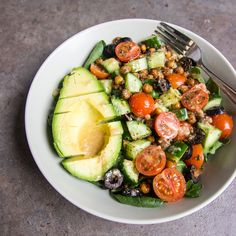 Fresh and delicious barbecue roasted chickpea avocado salad with cherry tomatoes and cucumber drizzled with rich roasted garlic dressing.