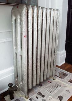 good radiator painting tips - plus great idea for cleaning radiators with a dryer vent brush. brilliant.