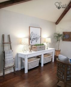 With only 8 2x6 framing boards that total around $40 in lumber, you can build this super cute DIY Farmhouse Console! Full tutorial and free plans!