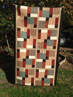 Nine patch with twist - earthy colours.