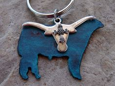 Whether you are a rancher, cowgirl or FFA student, this keychain is the perfect accessory! https://www.etsy.com/listing/276460444/show-steer-keychain-cowboy-keychain?ref=shop_home_active_12