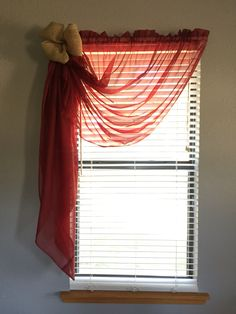 Sheer curtain with burlap tie up.
