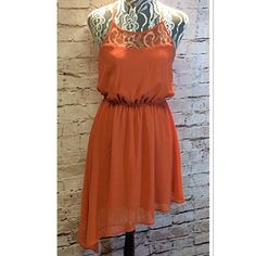 SEQUIN HEARTS ASYMMETRICAL STYLE DRESS Pretty dress in a burnt orange with an asymmetrical hem and a sheer panel in the front and back. Like new Sequin Hearts Dresses Asymmetrical