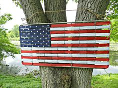Turn an old crib bedspring into an American flag, then prominently display it in your backyard on the 4th of July, or all year round!