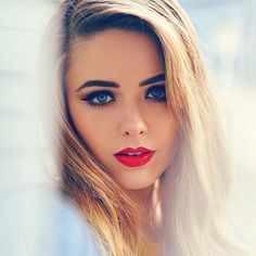 Love the red lips and makeup!