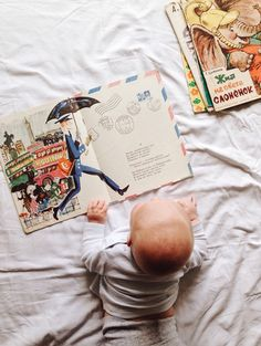 August 21st, Our Muse of the day, this little curious babe.  Inspire those new to this amazing world with stories, books, pictures...inspire the love of books. Evie & Adrienne || Sustainable Baby Clothing and Accessories || Made in America || Be The Good || Fertility Awareness || www.evieandadrienne.com