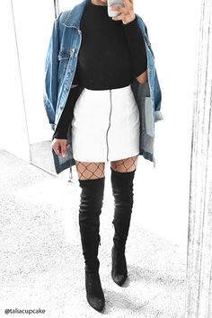 Style Deals - A knit denim mini skirt featuring an exposed zipper front.