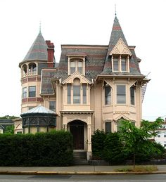 A wonderful Victorian in Providence, RI, a witch hat turret with upper open air balcony, and a steep eave on the right front to complement.  Front bay room is awesome.  Roof is very nice, but house could stand some paint to bring out the details.