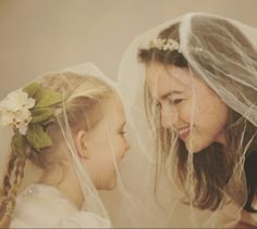 Best photos with your flower girl! Try putting your veil over her head for instant cute!  Www.withgracecouture.com