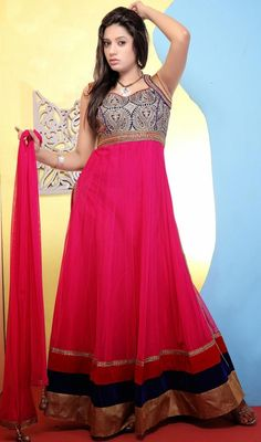 Be the picture of ethereal perfection dressed in this fuchsia shade net long Anarkali churidar suit. The attractive lace, resham and velvet patch work a substantial feature of this attire. #PartyWearAnarkali