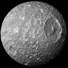 In this view captured by NASA's Cassini spacecraft on its closest-ever flyby of Saturn's moon Mimas, the large Herschel Crater can be seen. The crater is 130 kilometres, or 80 miles, wide