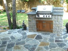 GroundScape and Fort Worth Landscape Company, stones in an outdoor grill with custom cedar doors. The silver mist flagstone patio was also installed by Groundscape. Outdoor Kitchen Patio, Outdoor Decor, Outdoor Kitchens, Cedar Door, Drainage Solutions, Flagstone Patio, Landscape Services, Landscaping Company, Backyard Bbq