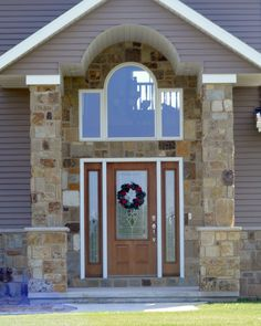 Taylor Stainable Steel door with sidelights from Waudena Millwork available @ Luedtke Lumber