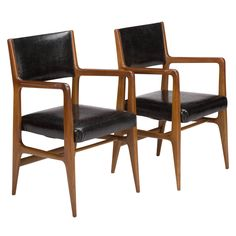 Pair of walnut and original black leather occasional armchairs by Gio Ponti, Italy, 1950, manufactured by Cassina for Singer and Sons, model no. 149. Literature: Singer and Sons, manufacturer's catalog, circa 1950, unpaginated. Signed.