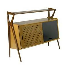 Louis Paolozzi; Mahogany and Oak Bar with Perforated and Black ...