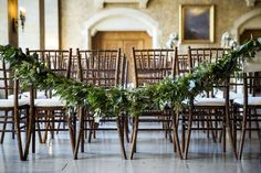 String a garland of greenery across the last row of ceremony seats for a chic touch.
