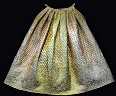 """Quilted Petticoat, 1755; Connecticut River Valley; Silk quilted to worsted backing, woolen batting, linen waistband; made by S. W.  """"This petticoat features diamonds filled with a variety of motifs, including flowers, fish, birds, and other animals; ready-made quilted petticoats were imported, some girls and women quilted their own petticoats at home. Many of them used imported materials, such as the silk in this example. © 2013 The Colonial Williamsburg Foundation"""