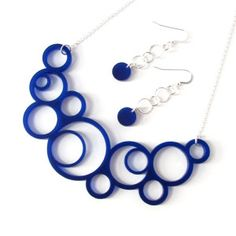 Stunning Statement Necklace!  Laser Cut Acrylic necklace and earrings set. Handmade with sterling silver and midnight blue acrylic with circle design.